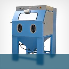 Wet blasting machines